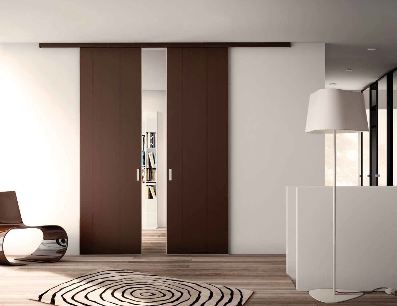 Puertas correderas de madera una soluci n c moda parquets tejada - Puertas correderas para separar ambientes ...